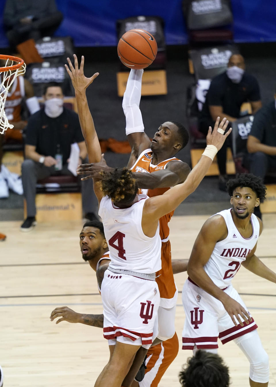 Texas guard Andrew Jones (1) leaps to the basket over Indiana guard Khristian Lander (4) and Indiana forward Jerome Hunter (21) in the second half of an NCAA college basketball game in the semifinals of the Maui Invitational tournament, Tuesday, Dec. 1, 2020, in Asheville, N.C. (AP Photo/Kathy Kmonicek)