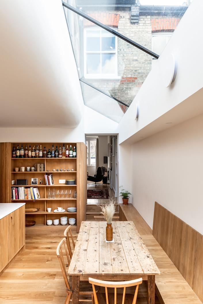 """<div class=""""caption""""> """"The main reason for having the open shelves came from seeing what an amazing whiskey collection the clients had when we first visited the house,"""" George reasons. </div> <cite class=""""credit"""">FRENCH+TYE</cite>"""