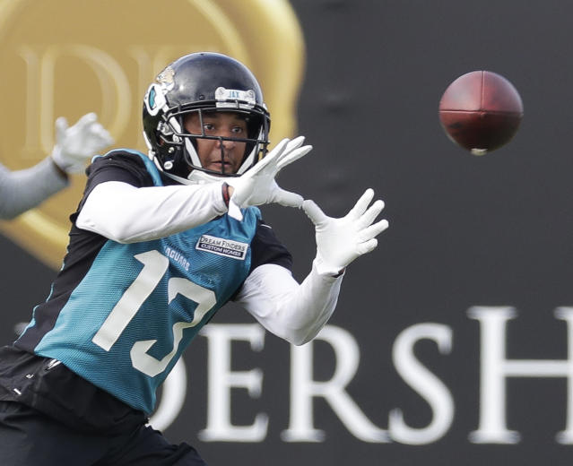 Jacksonville Jaguars wide receiver Rashad Greene catches a pass during NFL football practice Tuesday, June 12, 2018, in Jacksonville, Fla. (AP Photo/John Raoux)