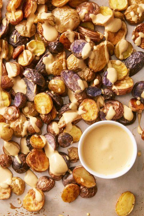 """<p>Your vegan friends deserve more than a sad vegetable platter this year. This nacho sauce is so good, everyone — vegans or otherwise —will want to drizzle it on everything you serve.</p><p><a href=""""https://www.goodhousekeeping.com/food-recipes/easy/a36256/crispy-potatoes-with-vegan-nacho-sauce/"""" rel=""""nofollow noopener"""" target=""""_blank"""" data-ylk=""""slk:Get the recipe for Crispy Potatoes with Vegan Nacho Sauce »"""" class=""""link rapid-noclick-resp""""><span class=""""redactor-invisible-space""""><span class=""""redactor-invisible-space""""><span class=""""redactor-invisible-space""""><span class=""""redactor-invisible-space""""><span class=""""redactor-invisible-space""""><em>Get the recipe for Crispy Potatoes with Vegan Nacho Sauce » </em></span></span></span></span></span></a><br></p>"""