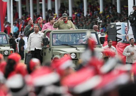 Venezuela's President Nicolas Maduro waves during a ceremony with militia members in Caracas