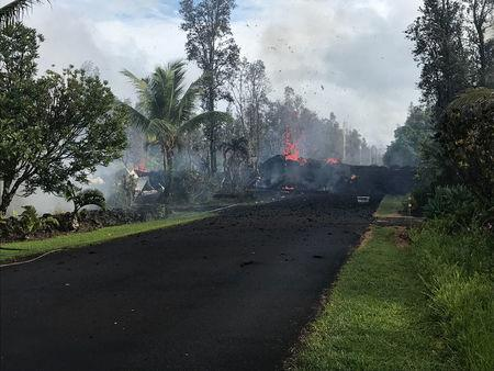 Hawaii volcano destroys 9 homes, spews lava 200 feet upward