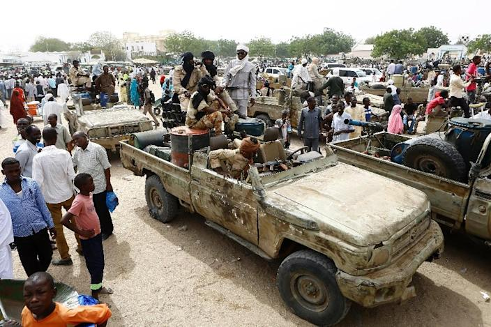 Fighters from the Sudanese Rapid Support Forces sit in vehicles in the city of Nyala, in south Darfur, on May 3, 2015, as they display weapons and vehicles they say they captured from Dafuri rebels and fighters from The Justice and Equality Movement (AFP Photo/Ashraf Shazly)