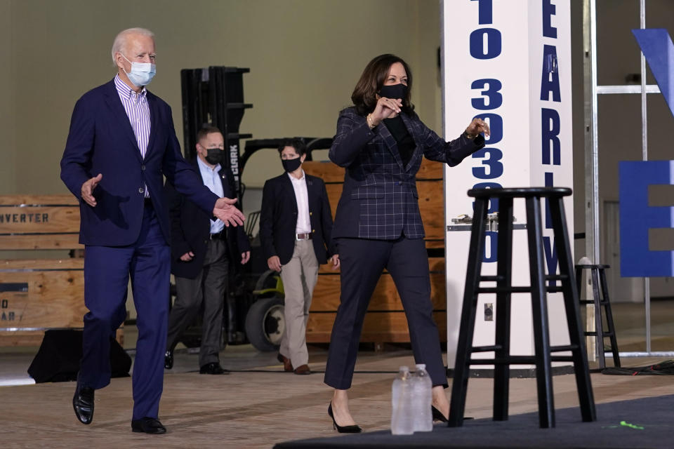 Democratic presidential candidate former Vice President Joe Biden and Democratic vice presidential candidate Sen. Kamala Harris, D-Calif., arrive the Carpenters Local Union 1912 in Phoenix, Thursday, Oct. 8, 2020, to kick off a small business bus tour. (AP Photo/Carolyn Kaster)