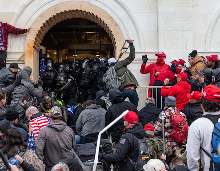 Rioters attacked police as they tried to enter the Capitol building through the front doors. One Capitol Police officer was killed. (Photo: Photo by Lev Radin/Pacific Press/LightRocket via Getty Images)