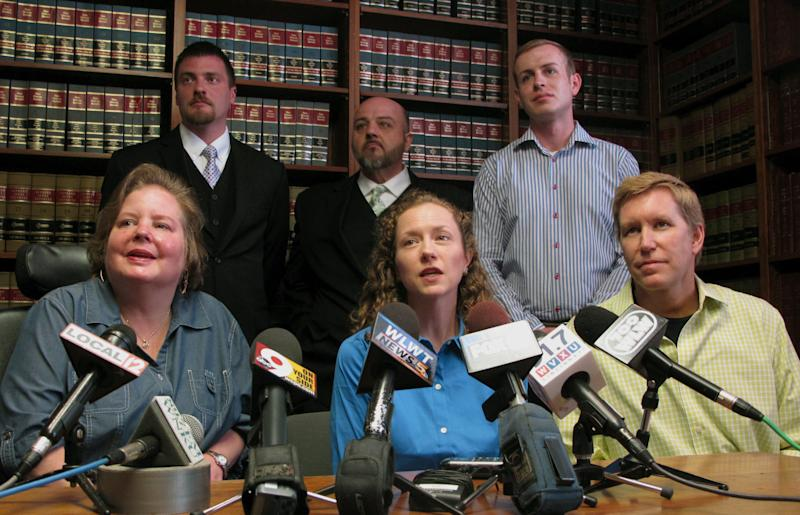 Some of the 12 plaintiffs named in a lawsuit seeking to strike down Ohio's gay marriage ban speak to media Wednesday, April 30, 2014 at a Cincinnati law firm. In the front row, from left, are Michelle Gibson, Mary Koehler, and Ronny Beck; in the back row, from left, are Karl Rece Jr., Gary Goodman, and Ethan Fletcher. All are involved in same-sex relationships and are seeking the right to marry in Ohio. (AP Photo/Amanda Lee Myers)
