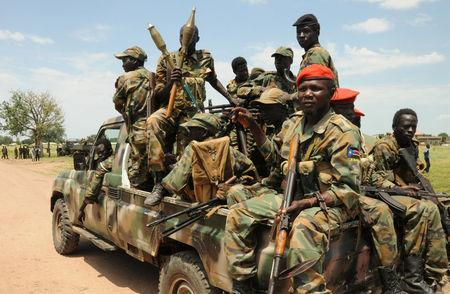 Sudan People's Liberation Army (SPLA) forces patrol the camp of Lalo, close to Malakal, South Sudan