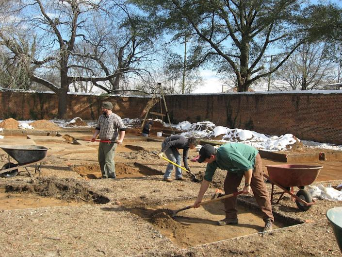 """In this Jan. 30, 2014 photo, In this Jan. 30, 2014 photo, crews excavate the site of """"Camp Asylum,"""" the Civil War-era prison that once held 1,500 Union officers on the grounds of the state mental hospital in Columbia, S.C., in the waning days of the Civil War. Racing against time, South Carolina archeologists are digging to uncover the remnants of a Civil War-era prisoner-of-war camp before the site in downtown Columbia is cleared to make room for a mixed-use development. (AP Photo/Susanne Schafer)"""