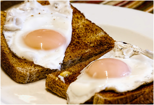 <p>Eggs contain good amount of protein. On reheating, they might be exposed to high temperatures which may destabilize its proteins and make it toxic. So, always avoid reheating scrambled or boiled eggs. However, it's relatively safer to reheat foods that contain eggs. </p>