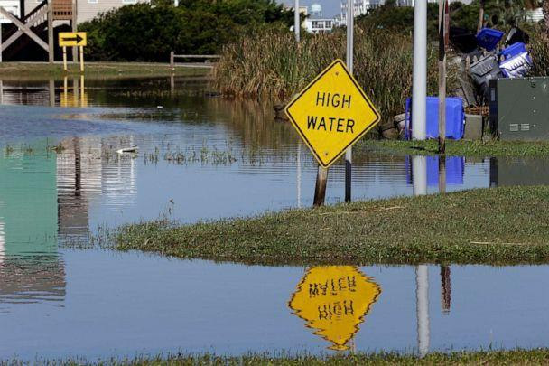 PHOTO: High water signs are posted along Ocean Drive following the effects of Hurricane Isaias in Caswell Beach, N.C., Aug. 4, 2020. (Gerry Broome/AP)