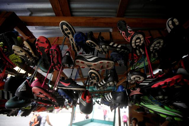 Soccer shoes are displayed for sale at an open air market in Tegucigalpa, Honduras May 19, 2018. REUTERS/Jorge Cabrera