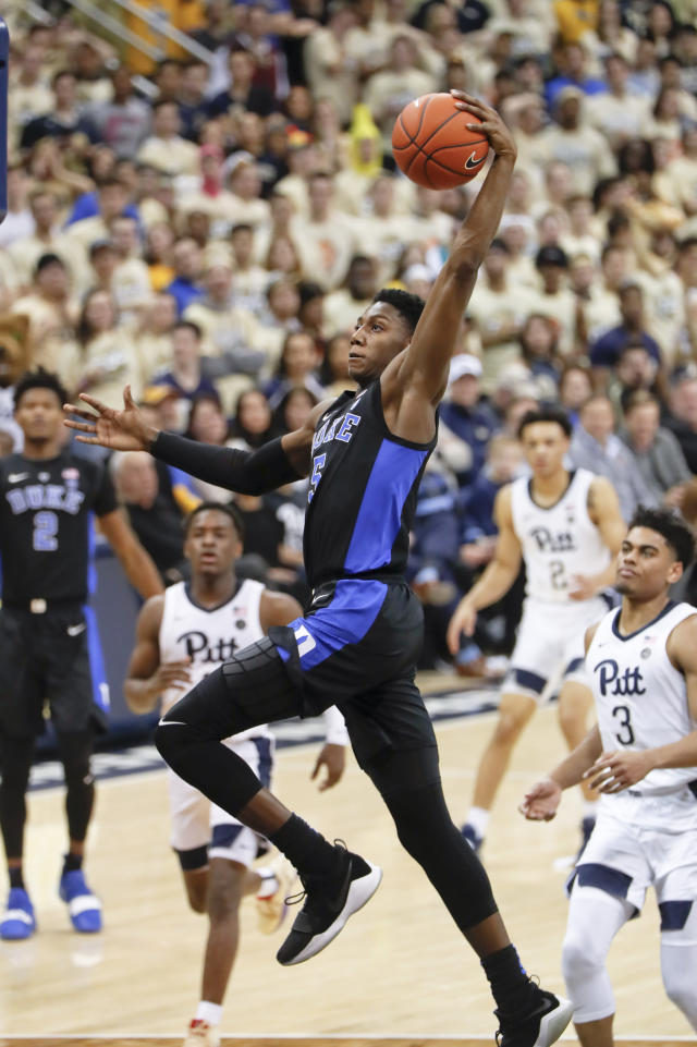 Duke's RJ Barrett (5) goes up for a dunk on a break away in front of Pittsburgh's Malik Ellison (3) during the second half of an NCAA college basketball game, Tuesday, Jan. 22, 2019, in Pittsburgh. (AP Photo/Keith Srakocic)