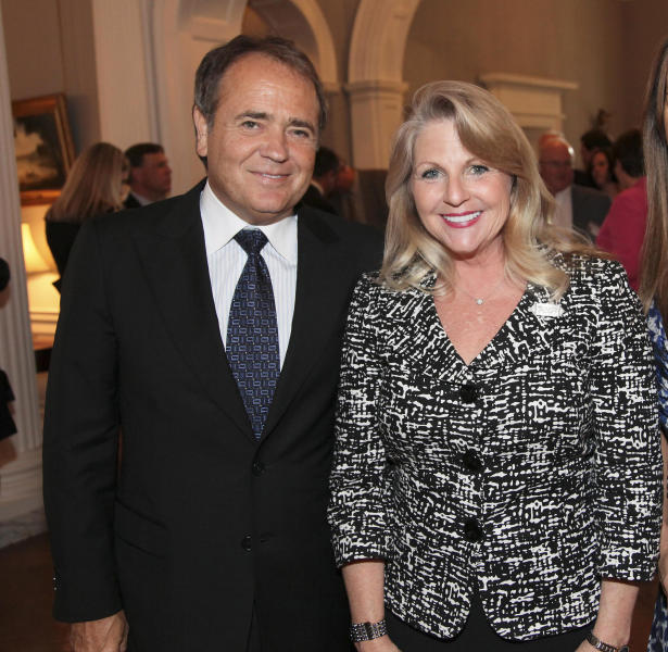 FILE - In this May 5, 2011 file photo provided by the office of the Governor of Virginia, Jonnie Williams left, and Maureen McDonnell, wife of then Gov. Bob McDonnell, pose for a photo during a reception for a NASCAR race at the Executive Mansion in Richmond, Va. The former first lady of Virginia and her husband, former Gov. Bob McConnell, have been indicted on several counts of trading on their influence to enrich themselves and family members. (AP Photo/Office of the Governor of Virginia, Michele White, File)