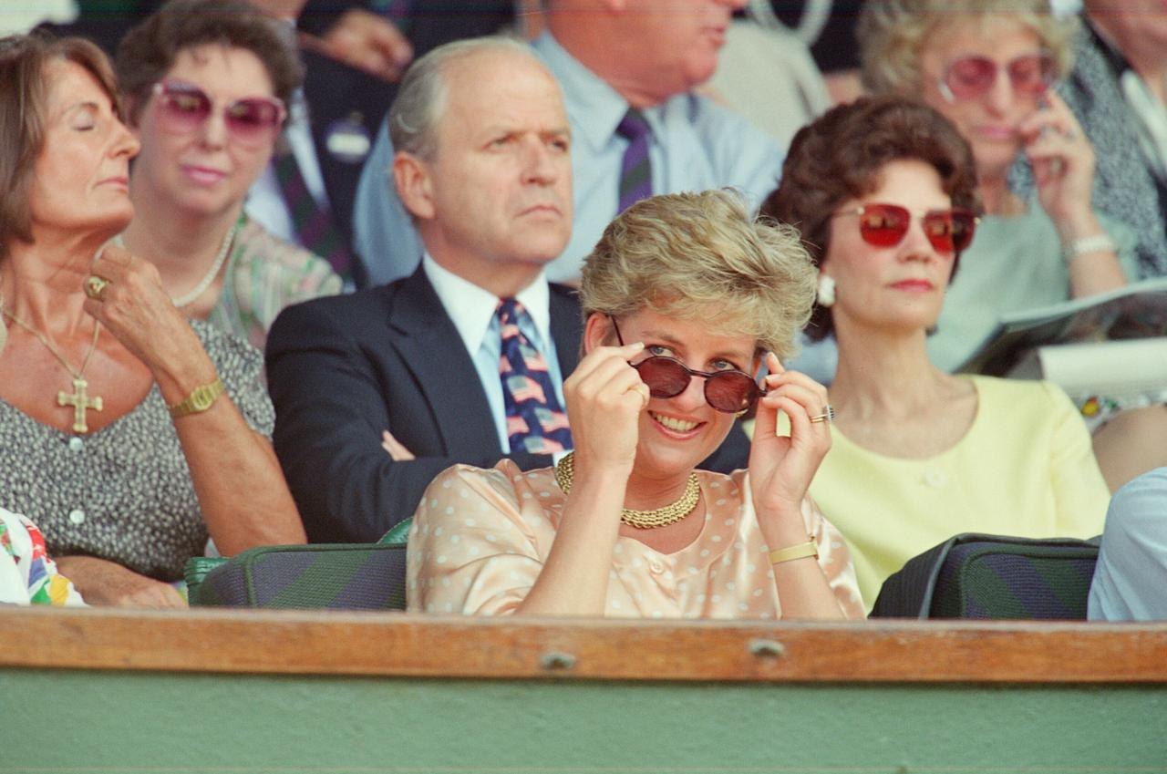<p>On 4 July 1993, Princess Diana demonstrated her sartorial prowess at the Men's Final in a silky polka dot blouse. <em>[Photo: Getty]</em> </p>