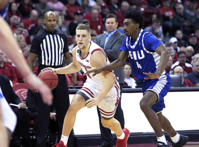 Wisconsin guard Brevin Pritzl (1) drives against the defense of Eastern Illinois guard Marvin Johnson (4) during the first half of an NCAA college basketball game in Madison, Wis., Friday, Nov. 8, 2019. (John Hart/Wisconsin State Journal via AP)