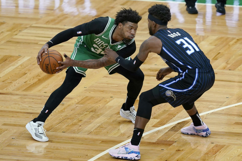 Boston Celtics guard Marcus Smart (36) makes a move against Orlando Magic guard Terrence Ross (31) during the first half of an NBA basketball game Friday, Jan. 15, 2021, in Boston. (AP Photo/Elise Amendola)