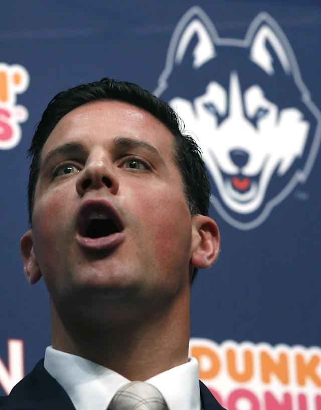 Bob Diaco, former Notre Dame defensive coordinator, speaks as Connecticut's new head football coach during an introductory news conference on campus in Storrs, Conn., Thursday, Dec. 12, 2013. (AP Photo/Elise Amendola)