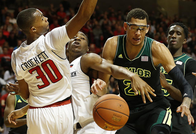 Texas Tech's Jaye Crockett (30) and Randy Onwuasor, center, battle for a loose ball against Baylor's Isaiah Austin (21) and Taurean Prince, right, during an NCAA college basketball game in Lubbock, Texas, Wednesday, Jan, 15, 2014. (AP Photo/Lubbock Avalanche-Journal, Tori Eichberger)