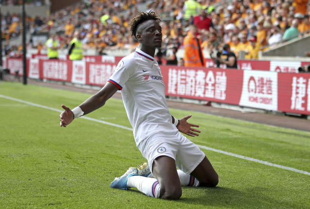 Chelsea's Tammy Abraham celebrates scoring his side's fourth goal of the game and his hat-trick during their English Premier League soccer match against Wolverhampton Wanderers at Molineux, Wolverhampton, England, Saturday, Sept. 14, 2019. (Nick Potts/PA via AP)