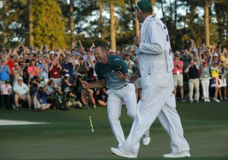 Sergio Garcia of Spain celebrates winning the Masters with a putt on the 18th green during a playoff against Justin Rose of England in the final round of the 2017 Masters golf tournament at Augusta National Golf Club in Augusta, Georgia, U.S., April 9, 2017. REUTERS/Mike Segar