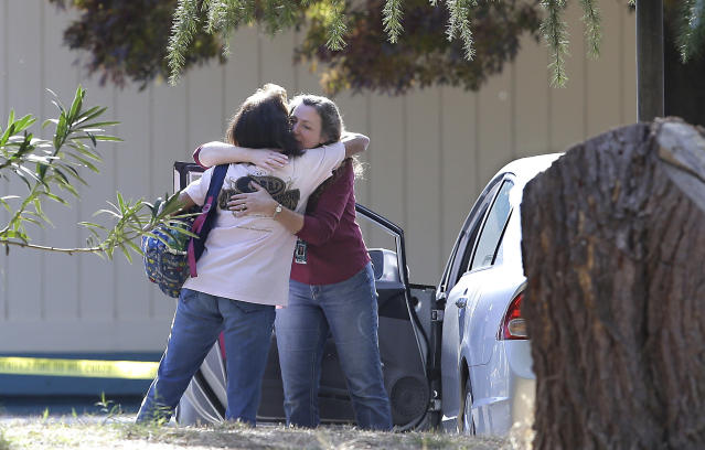 <p>Two women embrace outside Rancho Tehama Elementary School, where a gunman opened fire Tuesday, Nov. 14, 2017, in Corning, Calif. Authorities said, a gunman choosing targets at random, opened fire in a rural Northern California town Tuesday, killing four people at several sites and wounding others at the elementary school before police shot him dead. (AP Photo/Rich Pedroncelli) </p>