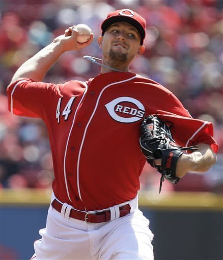 Cincinnati Reds starting pitcher Mike Leake throws against the Washington Nationals in the first inning of a baseball game, Saturday, April 6, 2013, in Cincinnati. (AP Photo/Al Behrman)