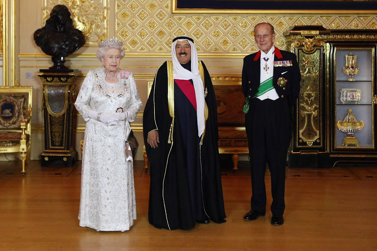 The Amir of the State of Kuwait, His Highness Sheikh Sabah Al-Ahmad Al-Jaber Al-Sabah poses with Queen Elizabeth II and the Duke of Edinburgh in Windsor Castle ahead of Official Banquet on the first day of his State Visit to the UK.