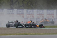 Red Bull driver Max Verstappen of the Netherlands followed by Mercedes driver Lewis Hamilton of Britain lead the field after the start during the Emilia Romagna Formula One Grand Prix, at the Imola racetrack, Italy, Sunday, April 18, 2021. (AP Photo/Luca Bruno)