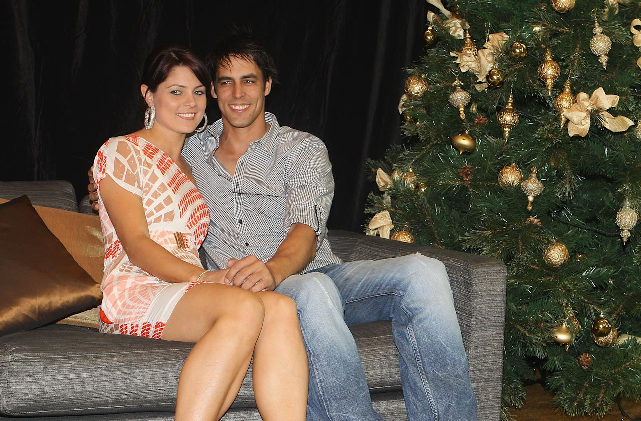 MELBOURNE, AUSTRALIA - DECEMBER 25:  Mitchell Johnson with Jessica Bratich during the Australian Cricket Team Christmas Celebrations at Crown Casino on December 25, 2010 in Melbourne, Australia.  (Photo by Hamish Blair/Getty Images)