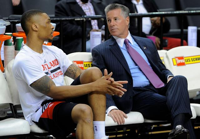 "The <a class=""link rapid-noclick-resp"" href=""/nba/teams/portland/"" data-ylk=""slk:Trail Blazers"">Trail Blazers</a> agreed to an extension with general manager Neil Olshey (right). (AP Photo/Greg Wahl-Stephens)"