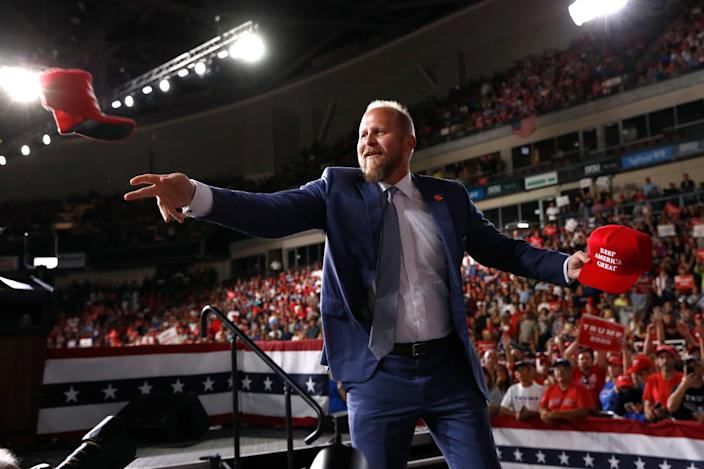 Brad Parscale, campaign manager for President Donald Trump, tosses a hat to supporters before Trump speaks at a campaign rally, Thursday, Aug. 15, 2019, in Manchester, N.H.