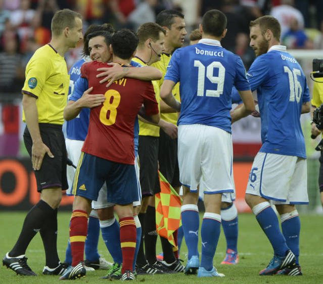 Italian forward Antonio Di Natale and Spanish midfielder Xavi Hernandez hugs at the end of the Euro 2012 championships football match Spain vs Italy on June 10, 2012 at the Gdansk Arena. AFP PHOTO / PIERRE-PHILIPPE MARCOUPIERRE-PHILIPPE MARCOU/AFP/GettyImages