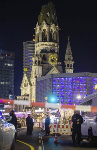 Police officers secure the evacuated Christmas market at the Breitscheidplatz in Berlin, Germany, Saturday, Dec. 21, 2019 after a suspicious object was found at the Christmas market. (Gregor Fischer/dpa via AP)
