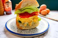 """<p>Whether you're an <a href=""""https://www.thedailymeal.com/recipes/dill-licious-egg-salad-recipe?referrer=yahoo&category=beauty_food&include_utm=1&utm_medium=referral&utm_source=yahoo&utm_campaign=feed"""" rel=""""nofollow noopener"""" target=""""_blank"""" data-ylk=""""slk:egg salad connoisseur"""" class=""""link rapid-noclick-resp"""">egg salad connoisseur</a> or you've avoided it in the past, this recipe will be a game changer. Avocado makes the <a href=""""https://www.thedailymeal.com/cook/how-hard-boil-eggs-and-peel-them-perfectly-every-time?referrer=yahoo&category=beauty_food&include_utm=1&utm_medium=referral&utm_source=yahoo&utm_campaign=feed"""" rel=""""nofollow noopener"""" target=""""_blank"""" data-ylk=""""slk:hard boiled egg"""" class=""""link rapid-noclick-resp"""">hard boiled egg</a> mixture extra creamy without drenching it in mayonnaise and the sriracha gives it a welcome kick.</p> <p><a href=""""https://www.thedailymeal.com/spicy-egg-salad-recipe?referrer=yahoo&category=beauty_food&include_utm=1&utm_medium=referral&utm_source=yahoo&utm_campaign=feed"""" rel=""""nofollow noopener"""" target=""""_blank"""" data-ylk=""""slk:For the Sriracha Avocado Egg Salad Sandwich recipe, click here."""" class=""""link rapid-noclick-resp"""">For the Sriracha Avocado Egg Salad Sandwich recipe, click here.</a></p>"""