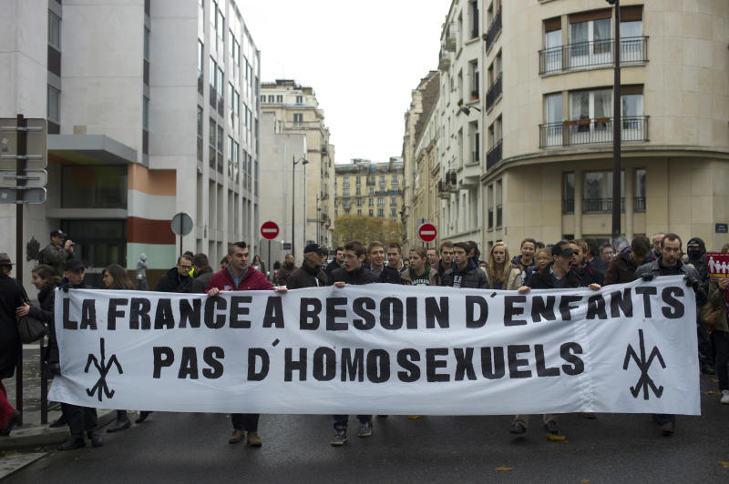 "People hold a banner during a protest organized by fundamentalist Christian group Civitas Institute against gay marriage, in Paris, Sunday, Nov. 18, 2012. Banner reads: ""France Needs Children, Not Homosexuals"". (AP Photo/Thibault Camus)"