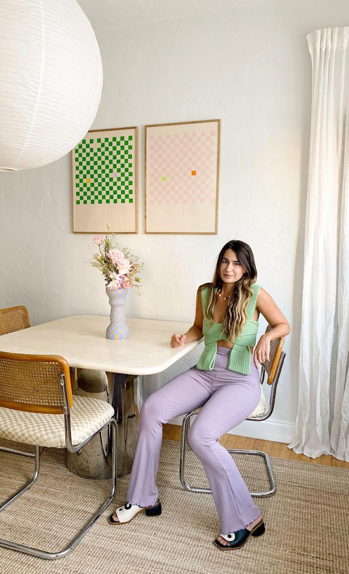 Carla at her travertine-and-chrome dining table, which she snagged from a private seller in Key Biscayne.