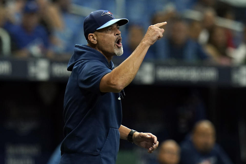 Toronto Blue Jays pitching coach Pete Walker yells at umpires after starting pitcher Ryan Borucki was ejected after hitting Tampa Bay Rays' Kevin Kiermaier with a pitch during the eighth inning of a baseball game Wednesday, Sept. 22, 2021, in St. Petersburg, Fla. (AP Photo/Chris O'Meara)