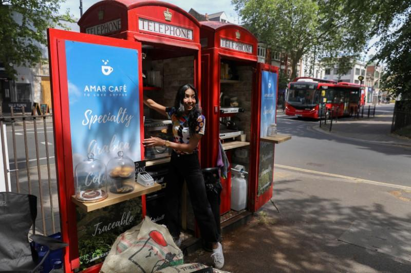 Converted telephone box operates as a take-way coffee shop