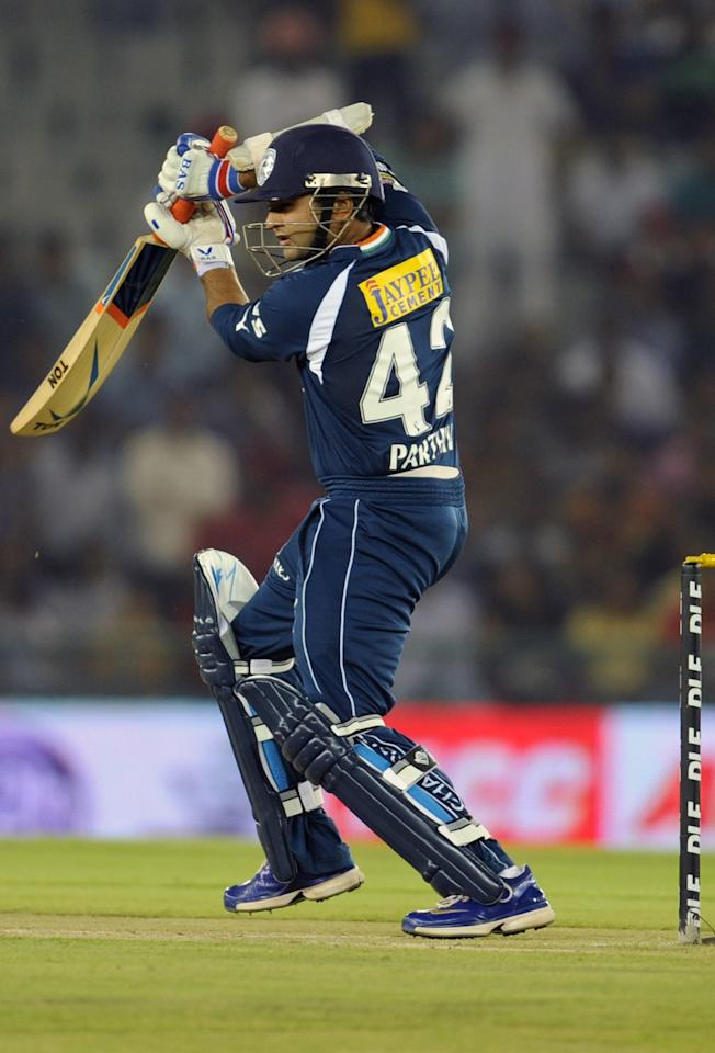 Deccan Chargers batsman Parthiv Patel plays a shot during the IPL Twenty20 cricket match between Kings XI Punjab and Deccan Chargers at the Punjab Cricket Association (PCA) stadium in Mohali on  May 13, 2012. RESTRICTED TO EDITORIAL USE. MOBILE USE WITHIN NEWS PACKAGE.  AFP PHOTO/SAJJAD HUSSAIN        (Photo credit should read SAJJAD HUSSAIN/AFP/GettyImages)