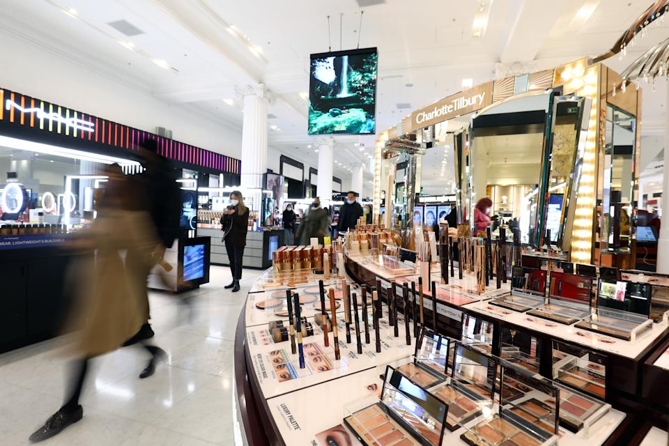 LONDON, ENGLAND - APRIL 12: Customers walk past the make up counters at Selfridges Store on April 12, 2021 in London, England. England has taken a significant step in easing its lockdown restrictions, with non-essential retail, beauty services, gyms and outdoor entertainment venues among the businesses given the green light to re-open with coronavirus precautions in place. Pubs and restaurants are also allowed open their outdoor areas, with no requirements for patrons to order food when buying alcoholic drinks. (Photo by Tim P. Whitby/Getty Images)