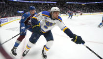 St. Louis Blues center Robert Thomas, right, reaches out for the puck as Colorado Avalanche defenseman Cale Makar pursues in the first period of Game 1 of an NHL hockey Stanley Cup first-round playoff series Monday, May 17, 2021, in Denver. (AP Photo/David Zalubowski)