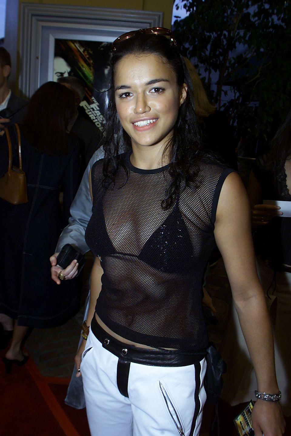 <p>Michelle Rodriguez was a relatively unknown actress when she appeared as Letty Ortiz in first <em>The Fast and the Furious.</em> Here, the young actress is photographed attending the premiere of the film in 2001. </p>