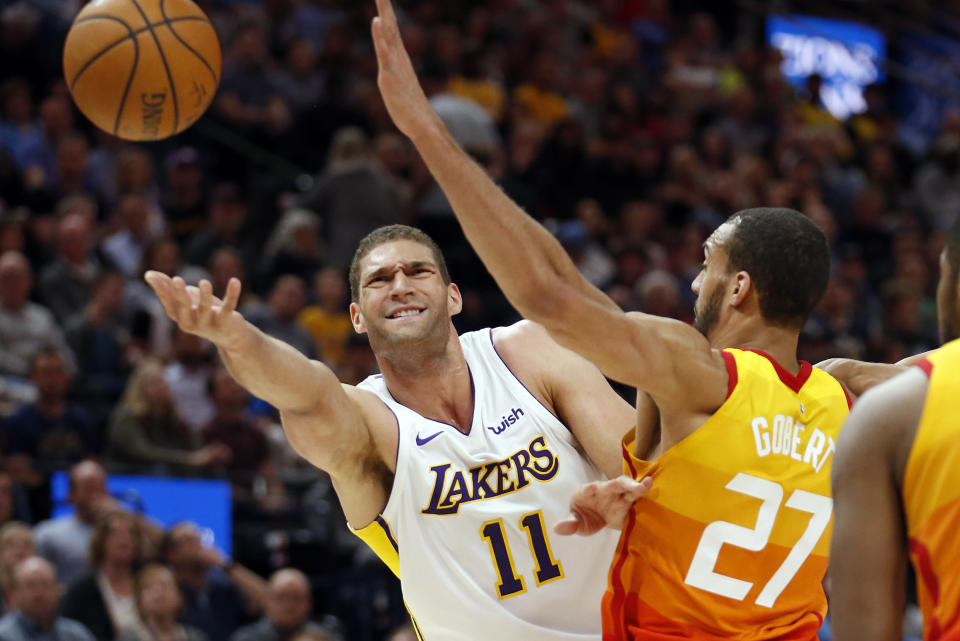Brook Lopez lays the ball up against Jazz center Rudy Gobert during an April game. (AP)