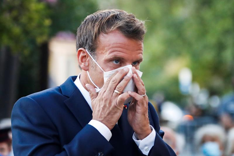 French President Emmanuel Macron wearing a mask. France has seen a sharp uptick in cases in recent days and was removed from the UK's travel exemption list last week. (Getty)