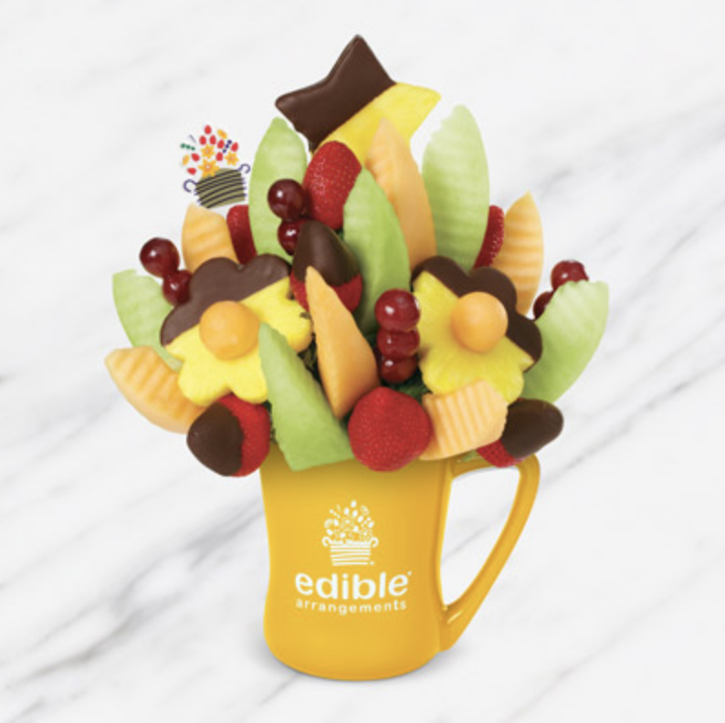 """<p>ediblearrangements.com</p><p><strong>$60.99</strong></p><p><a href=""""https://go.redirectingat.com?id=74968X1596630&url=https%3A%2F%2Fwww.ediblearrangements.com%2Ffruit-gifts%2Fdelicious-daisy-dipped-strawberries-pineapple-5805&sref=https%3A%2F%2Fwww.delish.com%2Fkitchen-tools%2Fg36269331%2Fbest-fruit-basket-delivery-services%2F"""" rel=""""nofollow noopener"""" target=""""_blank"""" data-ylk=""""slk:BUY NOW"""" class=""""link rapid-noclick-resp"""">BUY NOW</a></p><p>Edible Arrangements make any day a special occasion and look just as pretty as a bouquet of flowers. The Delicious Daisy arrangement includes dipped pineapple that resembles blooming flowers.</p>"""