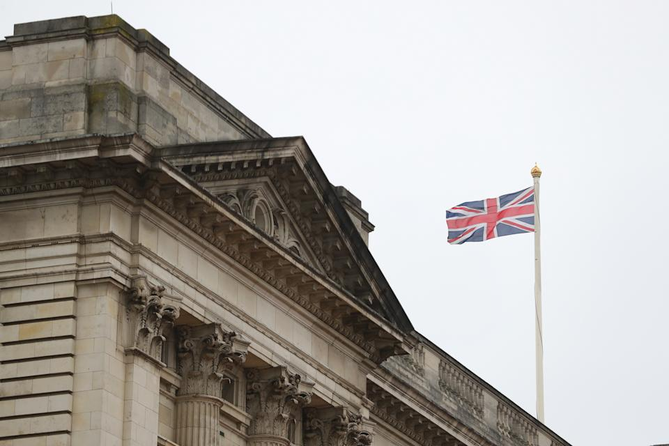 The Union Flag flies at Buckingham Palace after Queen Elizabeth II left London for Windsor Castle to socially distance herself amid the coronavirus pandemic. PA Photo. Picture date: Thursday March 19, 2020. She is heading to her Berkshire home a week earlier than she normally would at this time of year, and is expected to remain there beyond the Easter period. See PA story HEALTH Coronavirus Queen. Photo credit should read: Aaron Chown/PA Wire