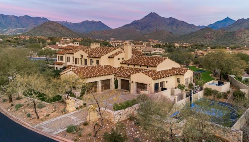 The 1.1-acre estate includes a 10,000-square-foot home with a batting cage, basketball court and rock climbing wall.
