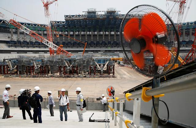 <p>Electrical fans are seen during a heat wave, at the construction site of the New National Stadium, the main stadium of the Tokyo 2020 Olympics and Paralympics, during a media opportunity in Tokyo, Japan July 18, 2018. (Photo: Issei Kato/Reuters) </p>