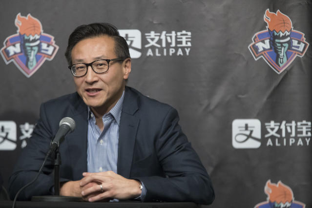 FILE - In this May 9, 2019, file photo, Joe Tsai speaks to reporters during a news conference before a WNBA exhibition basketball game between the New York Liberty and China in New York. Tsai has agreed to buy the remaining 51 percent of the Brooklyn Nets and Barclays Center from Mikhail Prokhorov in deals that two people with knowledge of the details say are worth about $3.4 billion. Terms were not disclosed Friday, Aug. 16, 2019, but the people told The Associated Press that Tsai is paying about $2.35 for the Nets — a record for a U.S. pro sports franchise — and nearly $1 billion in a separate transaction for the arena. (AP Photo/Mary Altaffer, File)