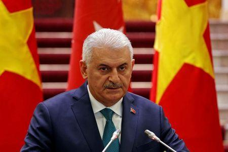 Turkish Prime Minister Binali Yildirim attends a press briefing with his Vietnamese counterpart Nguyen Xuan Phuc at the Government Office in Hanoi